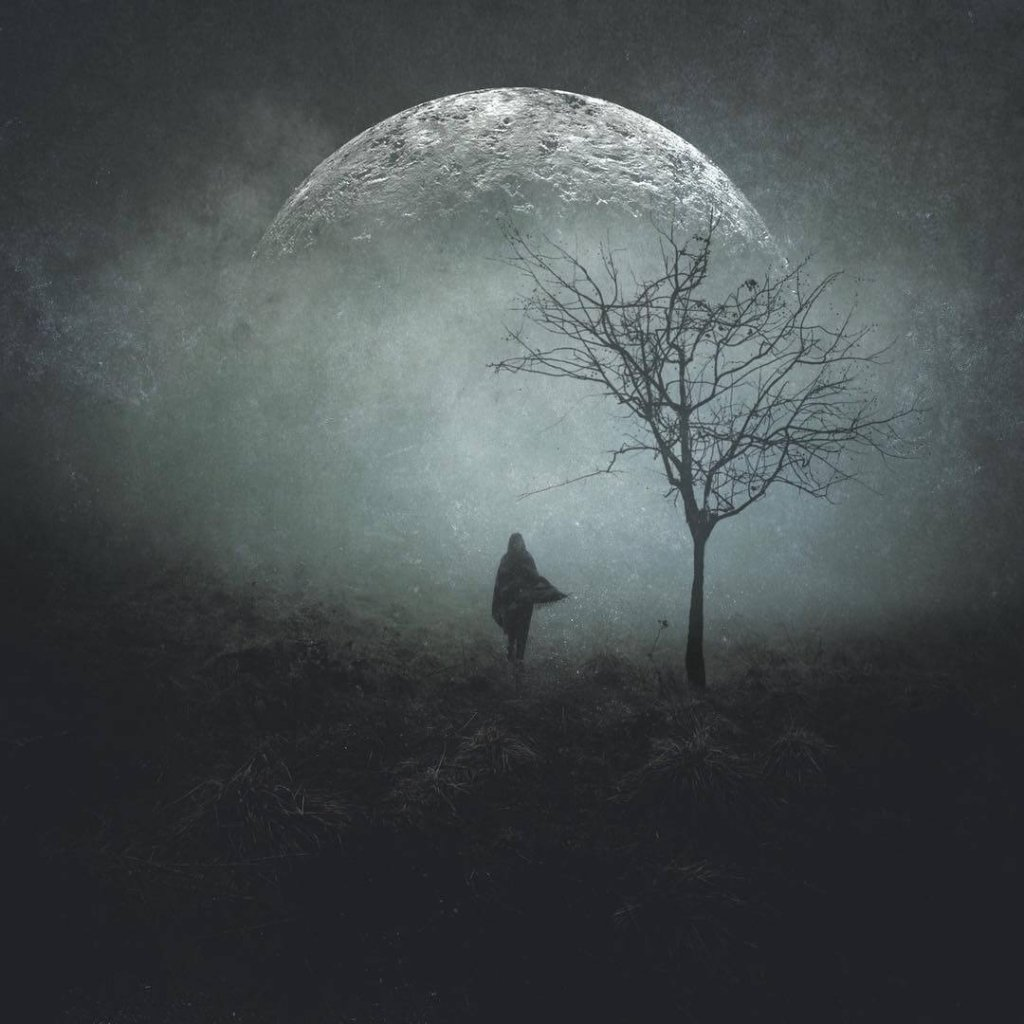 An image of a solitary figure standing in a misty landscape with a full moon and silhouetted tree by Amanda Parker