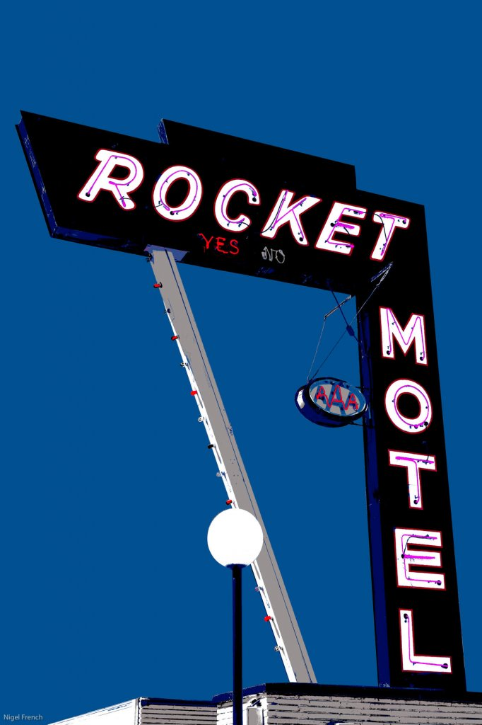 An photo of a vintage motel sign edited to resemble graphic art