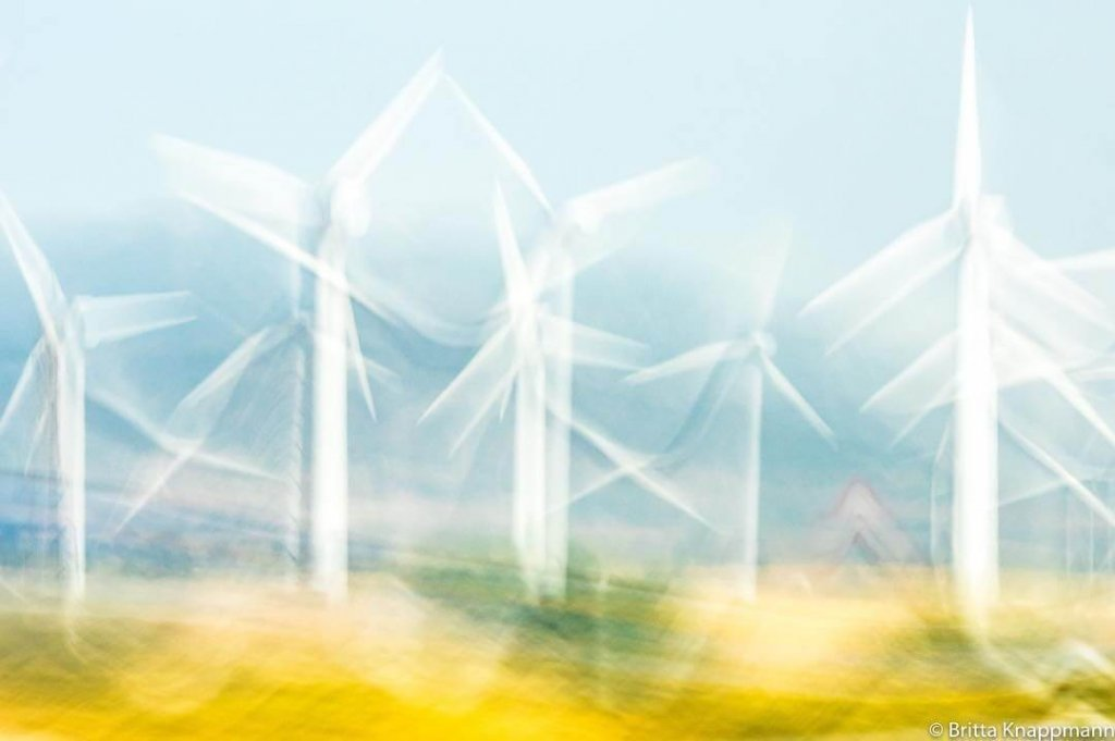 Abstract architecture photo art of wind turbines in a field