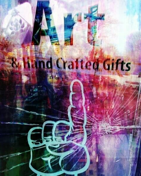 A frenetic pop-art image showing hand pointing to a sign for art and hand-crafted gifts