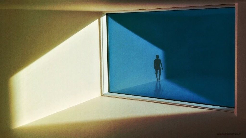 A calming, minimalist image of a room divided by a window with a single figure of a person