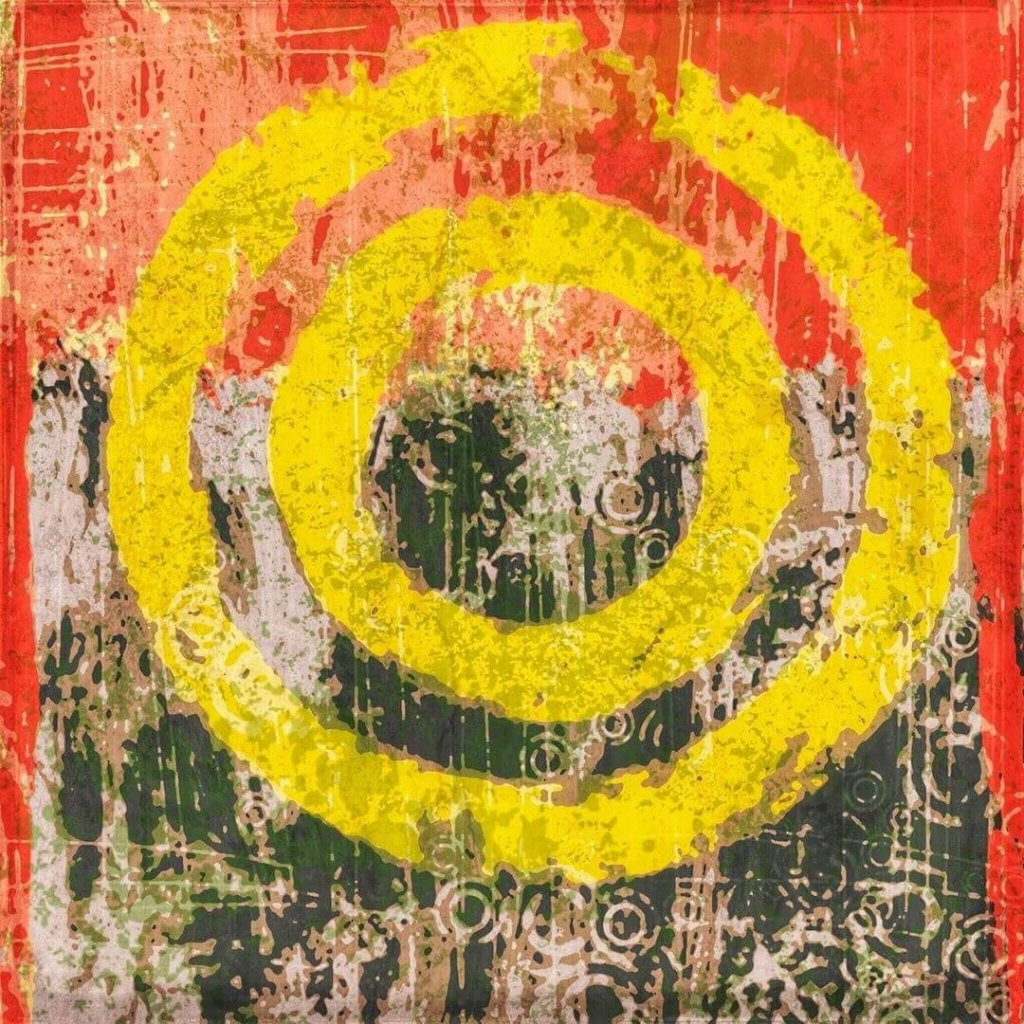 An energetic abstract of concentric yellow circles on a red and green background