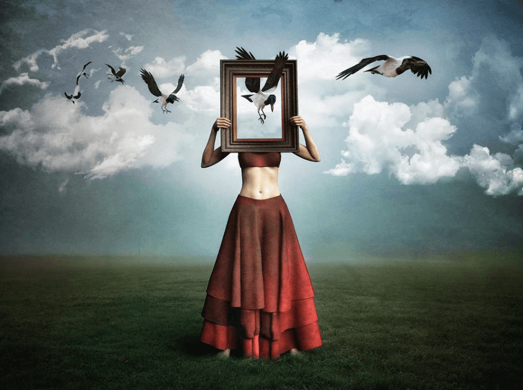 A woman in a red skirt holds up a picture frame in front of her face, which a series of birds is flying through