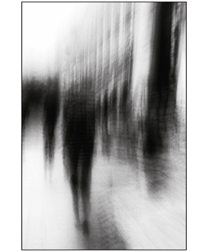 Dreamy Distortions: Elongated shadowy figures in a blurred street scene