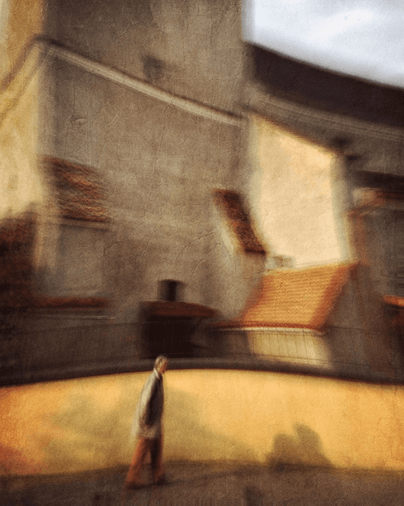 A dreamy, distorted image of man walking in front of a church