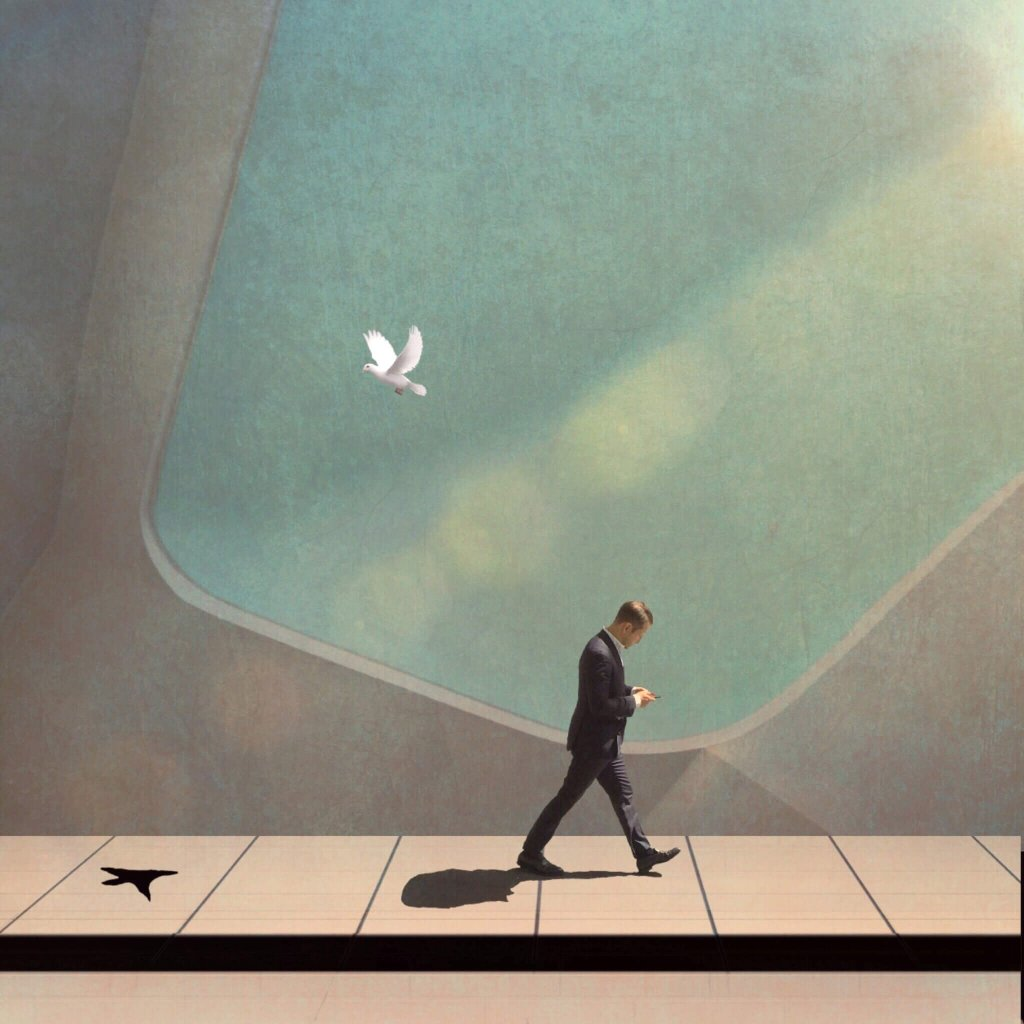 A man walking looking at his mobile phone. A dove flies above him - Humberto Dominguez