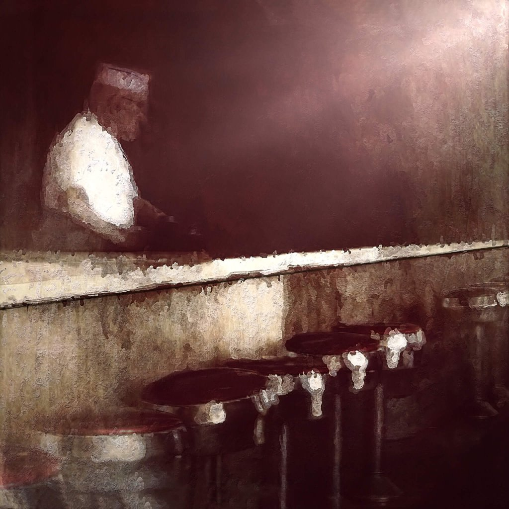 A hazy bar scene with empty stools and a bartender in a white shirt - Humberto Dominguez