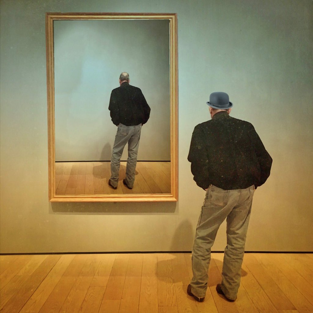 An elderly man in a bowler hat faces a mirror where he is reflected from the same viewpoint without a hat - Humberto Dominguez